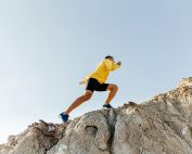 man climbing a mountain | HR Business Consultant