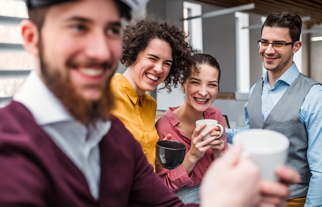 Coworkers enjoy a coffee break | Featured image for Bramwell Partners blog 'Swearing in the Workplace'.