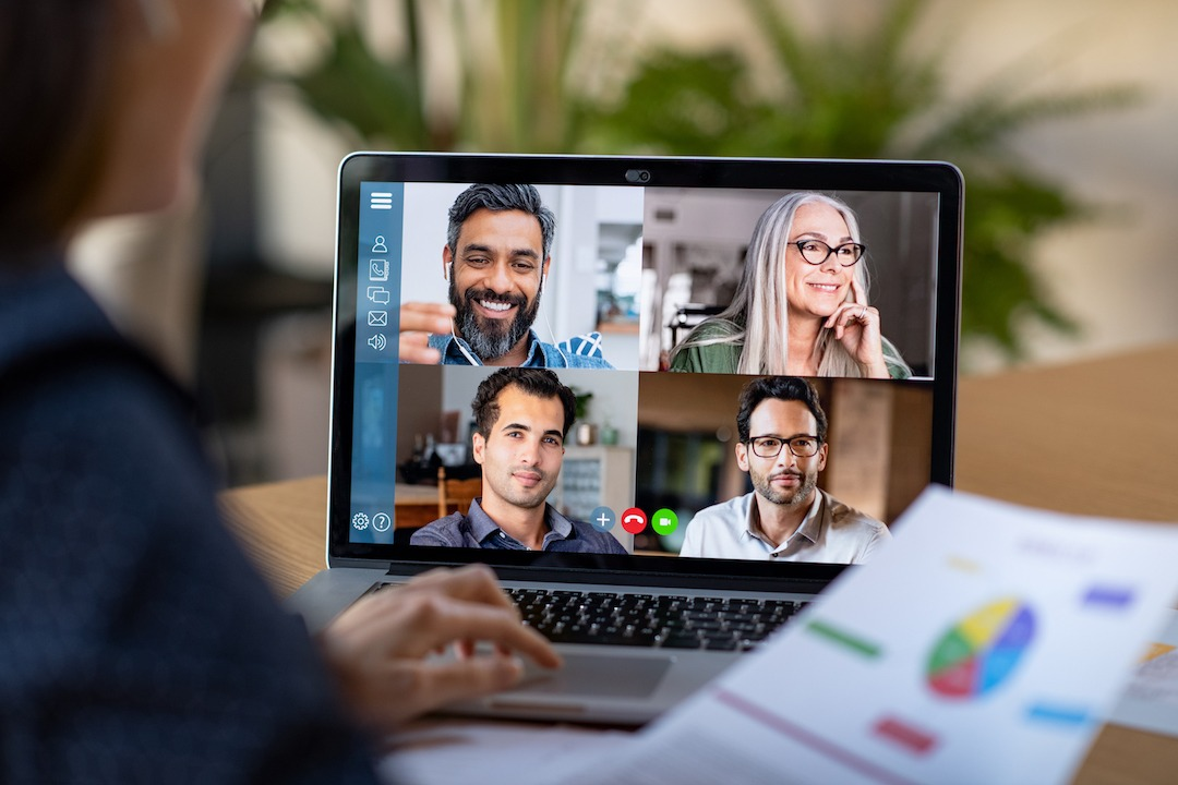 Person in a video conference call | Featured Image for Managing Online Meetings