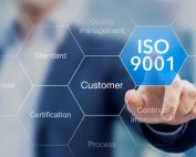 Person pointing to an ISO 9001 bubble   Featured image for what is ISO9001 blog.