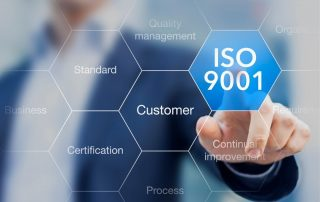 Person pointing to an ISO 9001 bubble | Featured image for what is ISO9001 blog.