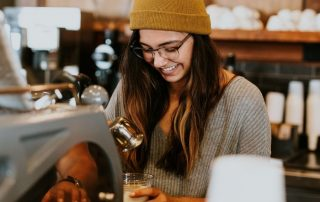 Young lady barista working at a cafe | Featured image to Recent amendments to the fair work act 2009